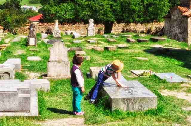 Children playing in a churchyard