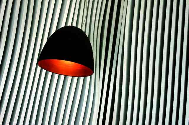 Suspended Lamp on a Curvy Wall