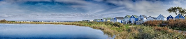 Panoramic view of beach Huts on waters front