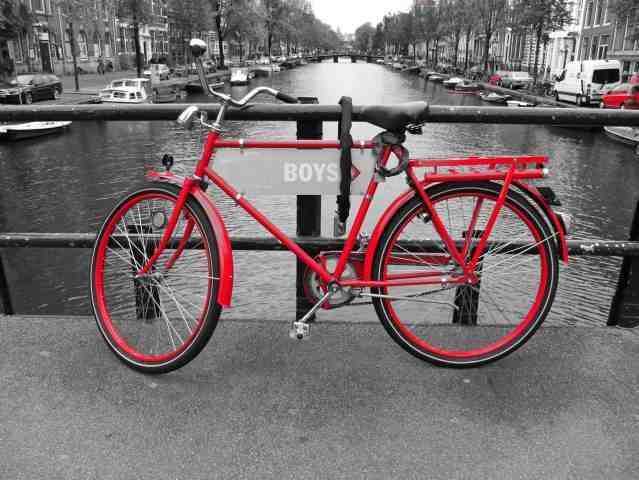 Amsterdan red bike on the channel
