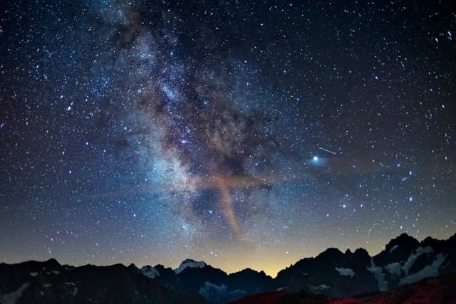 The Milky Way and starry sky on the Alps